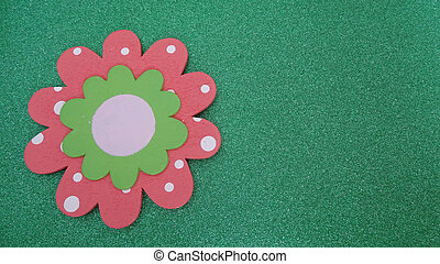Pink flower on a green background