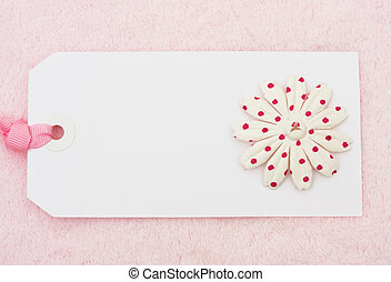 Pink Flower Tag - A pink flowers on a blank tag on a pink...