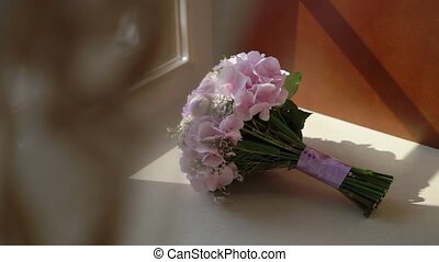 Pink flowers bridal wedding bouquet indoors in bedroom near...