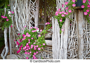 Pink flowers in a basket.