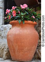 Pink flowers in old vase