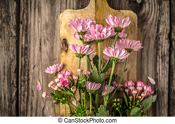 Pink flowers on the wooden board horizontal