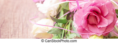 Pink flowers on wooden background. Concept for greetings card. Banner image