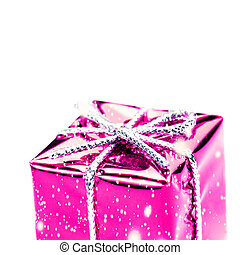 Pink gift box with silver ribbon, bow and snowflakes isolated on white macro. Christmas, Valentine's, Birthday gift box