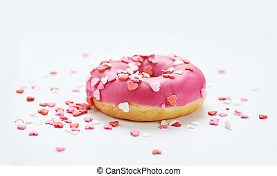 pink glazed doughnuts with sprinkles
