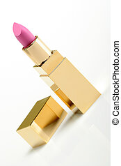 Pink golden lipstick on white background