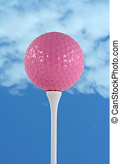 Pink golf ball against blue sky