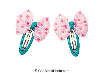 Pink hairclips with bow over white