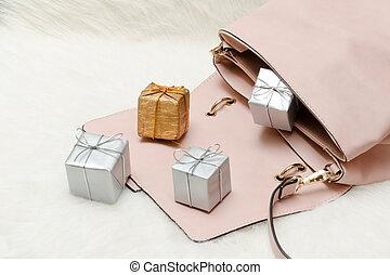 Pink handbag with small gift boxes. Holiday concept