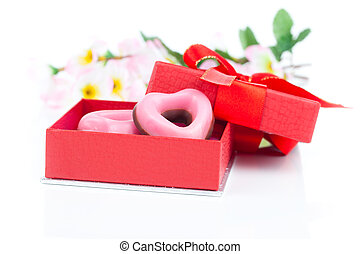 pink heart cookies  for valentines day in red gift, on white background