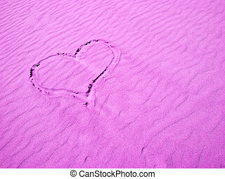 Pink Heart in the Sand on a Sunny Day