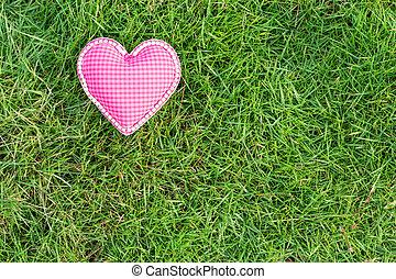 pink heart love on green grass