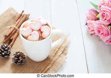 Pink heart marshmallows on hot chocolate in white cup. Love concept