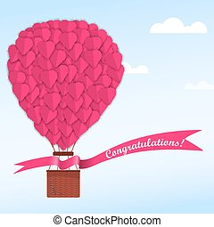 Pink heart on a balloon in a blue sky with clouds