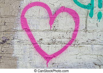 Pink heart on the Brick wall background