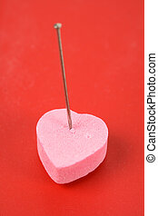 Love Curse - Pink Heart Shape Candy and pin, concept of Love...