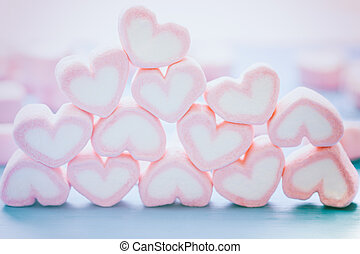 Pink heart shape marshmallow for love theme and Valentine background concept. Pile of heart. Romance pink heart pastel color. Love inscription from sweet food. Sweet love holiday background