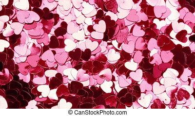 Glittering pink heart shaped confetti