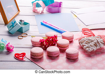 Pink heart shaped macaroons and wedding rings with postcard, Photo frame
