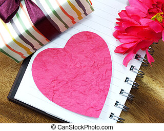 pink heart valentine concept on wooden background and beautiful flower