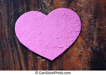 pink heart with wood background