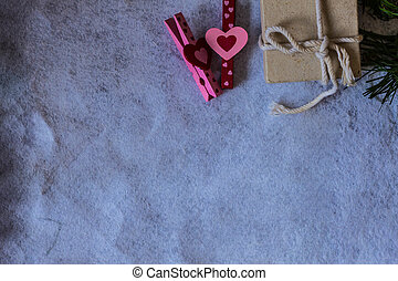 Pink hearts and a gift on background.