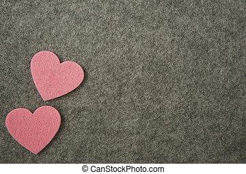 pink hearts on gray felt background. valentine's day