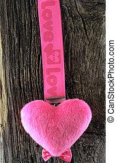 Pink hearts on old blackboard