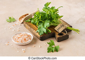 Pink Himalayan salt and a bunch of fresh parsley with a tag.