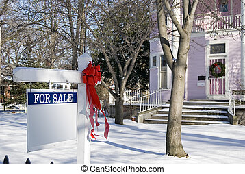 Pink House For Sale - Red holiday bow on for sale sign.