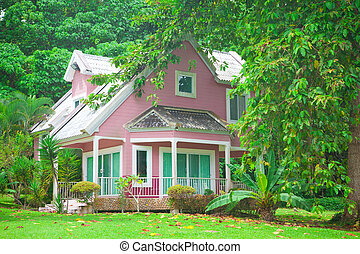 pink house in forest - Beautiful pink house and big tree in...