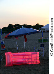 Pink inflatable mattress on the sandy beach