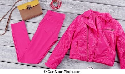 Pink jacket and pants. White shoes and bright trousers....