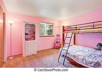 Pink kids bedroom with white furniture and carpet floor.