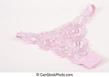 Pink lace g-string on white background