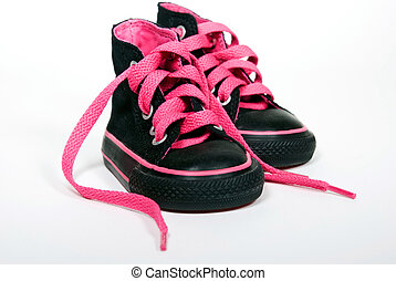 Pink Laces - Hot pink laces in kid\'s sneakers.