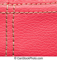 Pink leather - Macro of pink stitched leather as a...