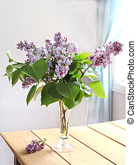 Pink lilac bouquet in vase