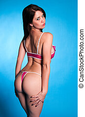 Pink lingerie - Beautiful young brunette dressed in pink...