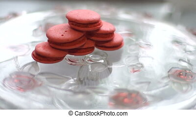 Pink macaroon cookies in the shape of a pyramid falls