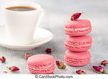 Pink macaroons on a vintage plate and dried flower buds. Pastel colored