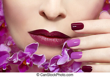 Pink maroon manicure.