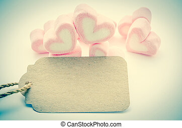Pink Marshmallow heart shape with blank paper tag.