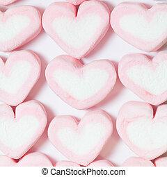 Marshmallows - pink Marshmallows of heart shape, on white...