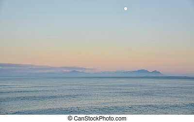 Pink Morning - Seascape with pink light and full moon over...