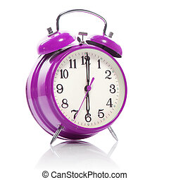 pink old style alarm clock isolated on white
