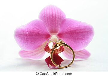 pink orchid and solitaire engagement ring