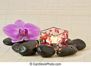 Pink orchid and zen Stones with a candle