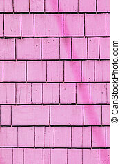 pink painted wooden shingles at the roof