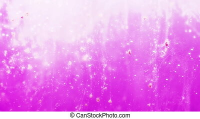 Pink particles floating in water